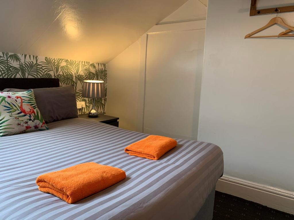 A bed or beds in a room at Tropics Beach Hotel