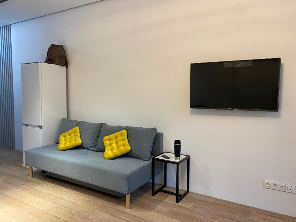 A television and/or entertainment centre at Premium apartment Match Point