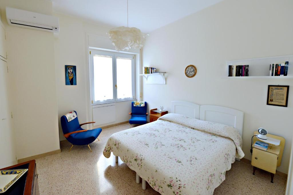 A bed or beds in a room at Casa Vacanze Centro Storico