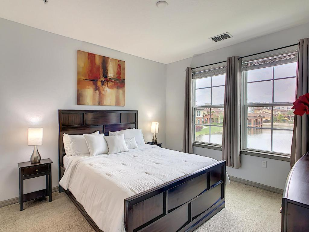 A bed or beds in a room at A Luxury Stay, Close to Disney