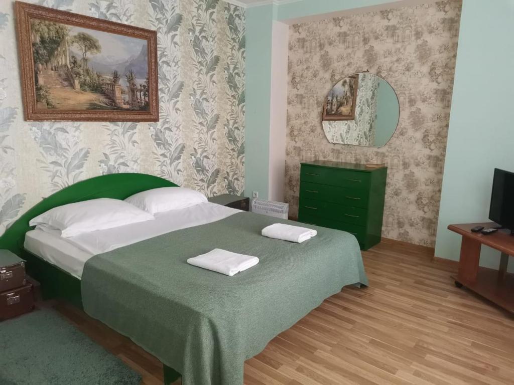 Кровать или кровати в номере ЧемоданЪ