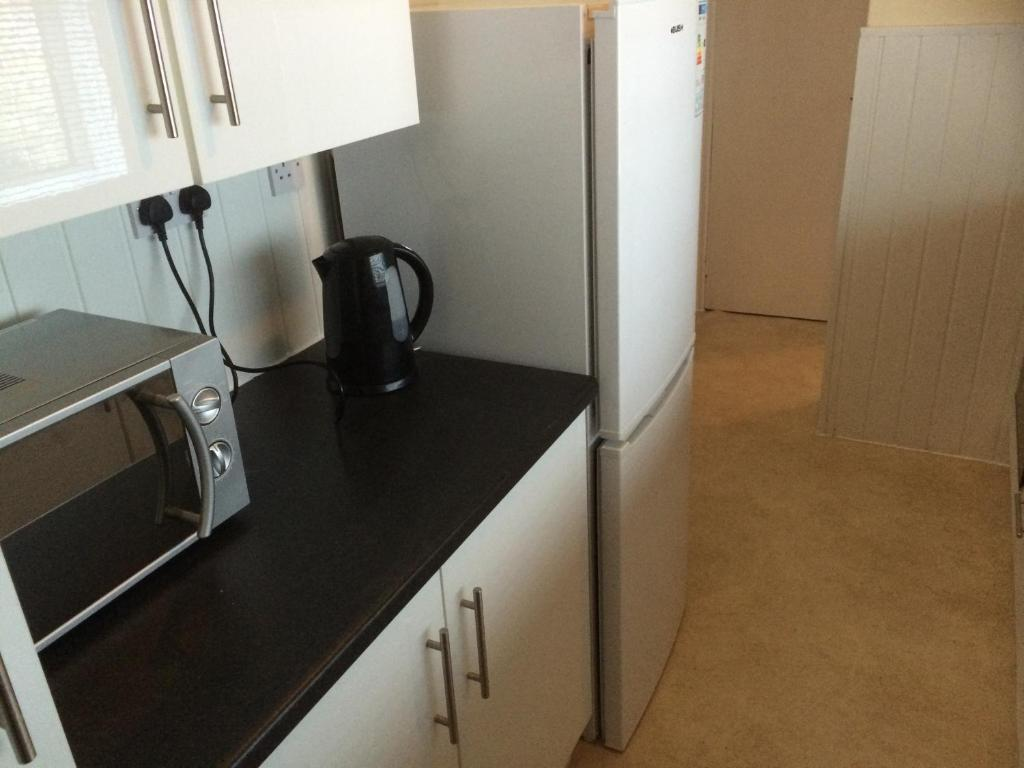 A kitchen or kitchenette at Yarm Road Serviced House