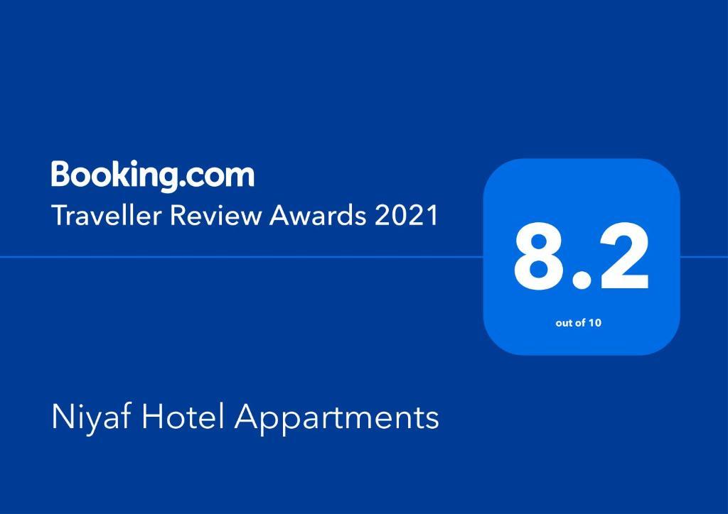 Um certificado, prêmio, placa ou outro documento exibido em Niyaf Hotel Appartments