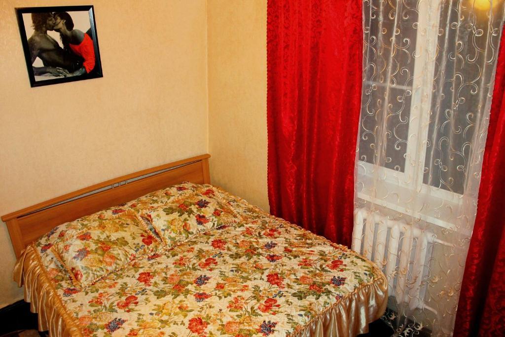 Кровать или кровати в номере Apartment on Pobeda 2
