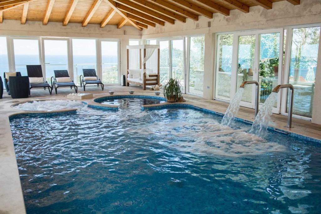 The swimming pool at or close to Villa Dubrovnik Platinum A Beautiful 5 Bedroom Villa Sea Views Gym Sauna Indoor Pool