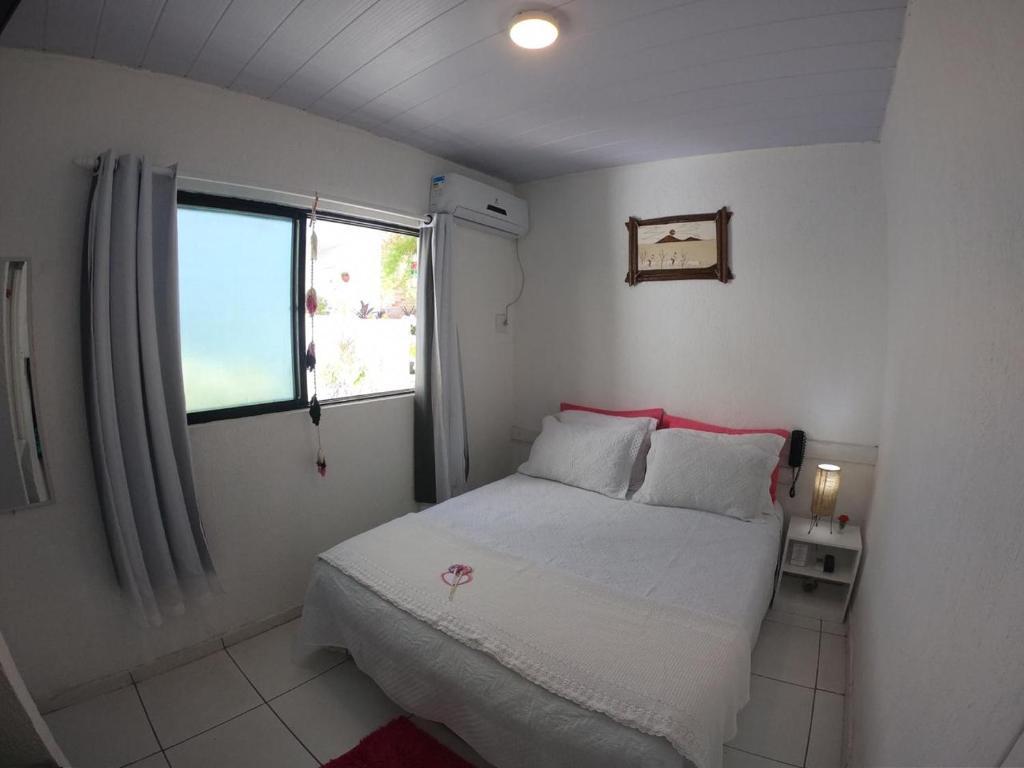 Cama ou camas em um quarto em Pousada America do Sol