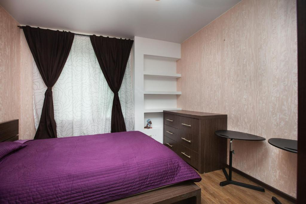Кровать или кровати в номере Business Brusnika Apartments VDNKH