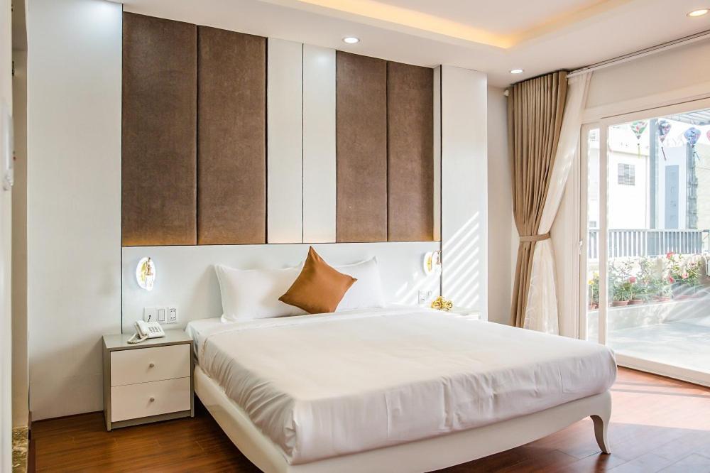 Giường trong phòng chung tại Mayana Hotel