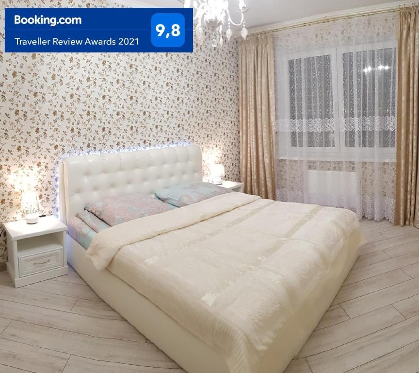 Кровать или кровати в номере Апартаменты У Марии