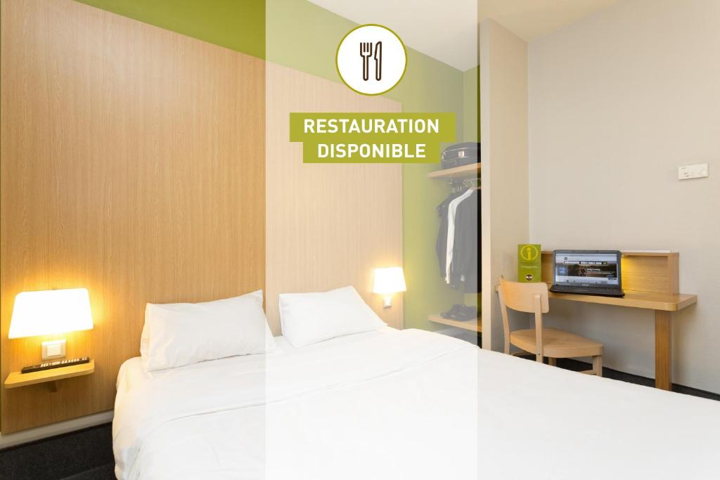 A bed or beds in a room at B&B Hôtel Marseille Euromed