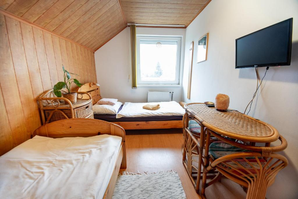 A bed or beds in a room at Mandala panzió