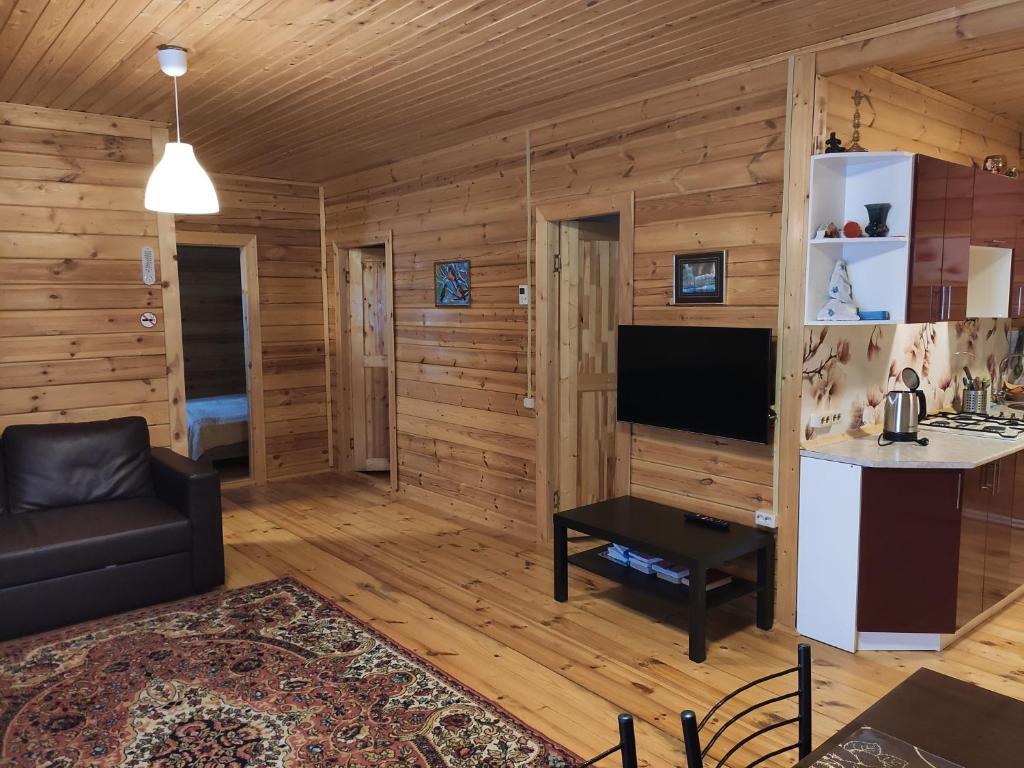 Телевизор и/или развлекательный центр в Загородный дом Снегири