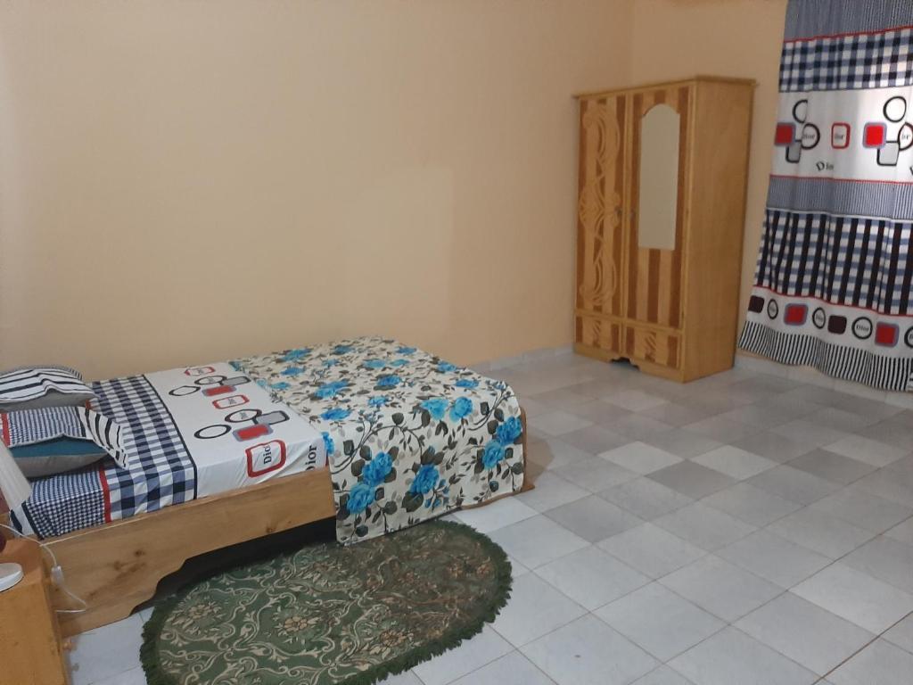 Un ou plusieurs lits dans un hébergement de l'établissement Villa Chambre A climatisée douche Cuisine salon