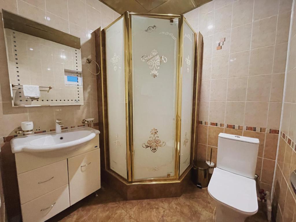 Ванная комната в Отель Снежная Королева Домбай