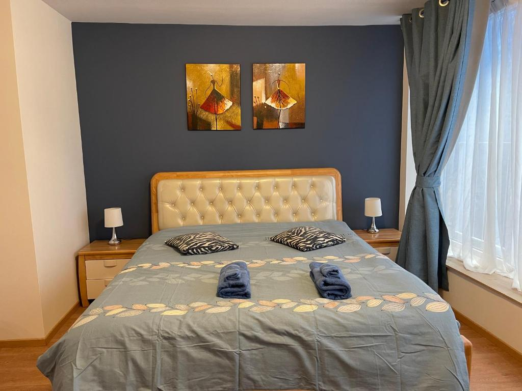 A bed or beds in a room at Gîtes Sax 2