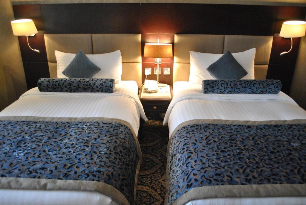 A bed or beds in a room at Chelsea Plaza Hotel