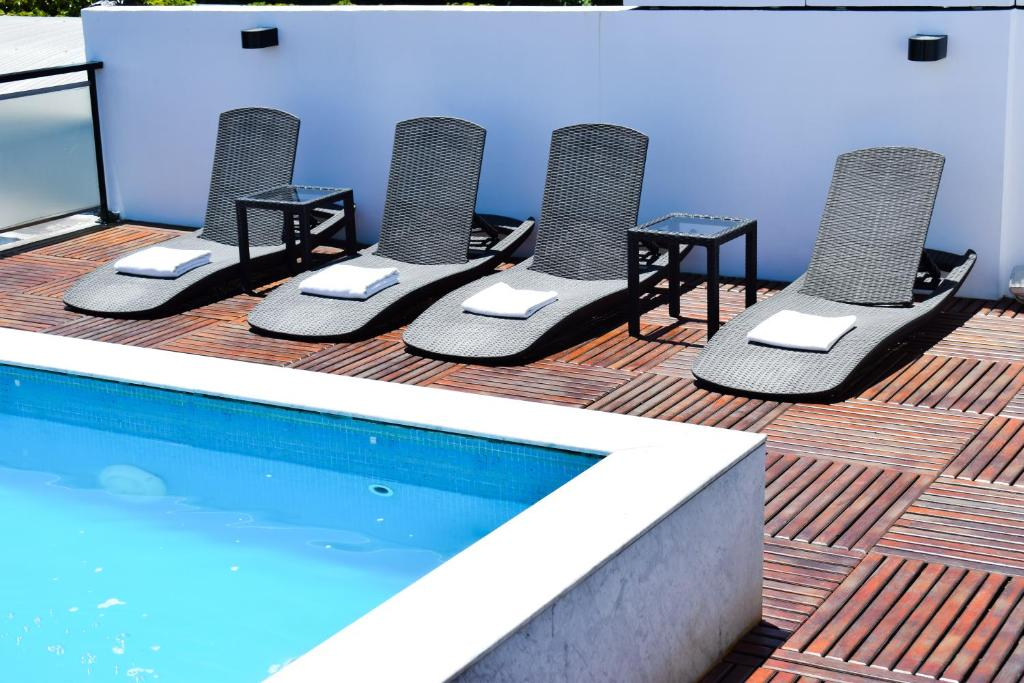 The swimming pool at or near Hotel Palermitano by DecO