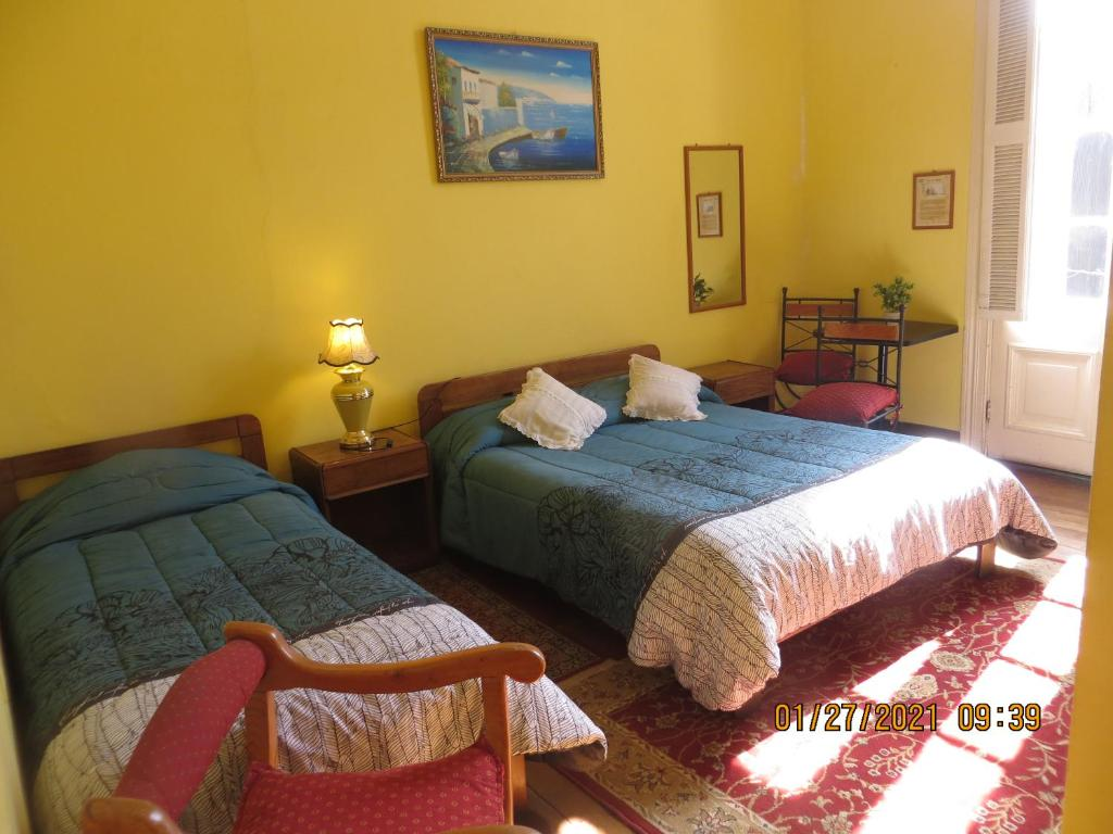 Cama o camas de una habitación en Hostal El Rincon Marino