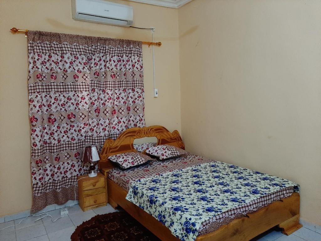 Un ou plusieurs lits dans un hébergement de l'établissement Villa Chambre C climatisée douche Cuisine salon