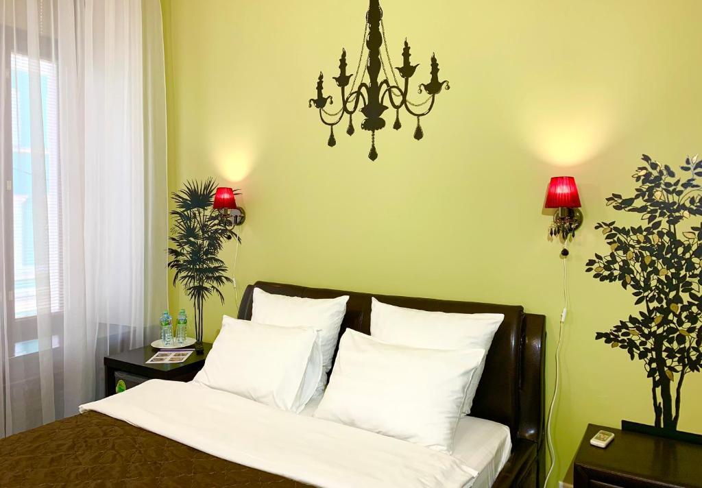 Кровать или кровати в номере Бутик-отель Сретенский Двор