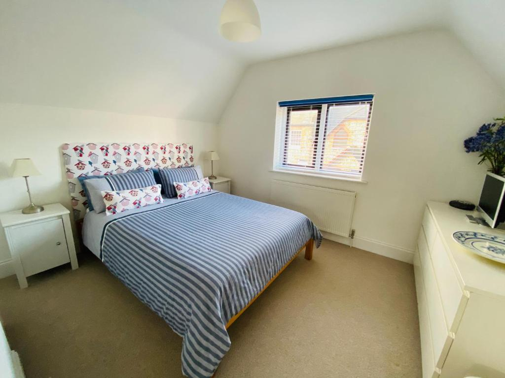 A bed or beds in a room at The Coast House