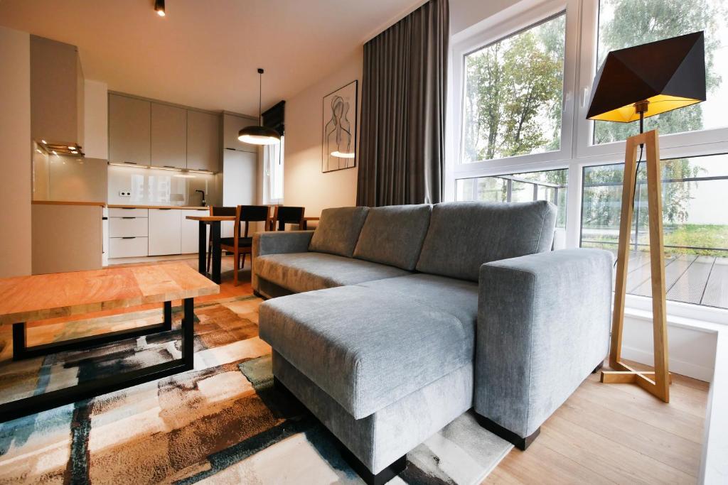 Część wypoczynkowa w obiekcie Apartament Wrocławska NOWA 5 DZIELNICA Centrum