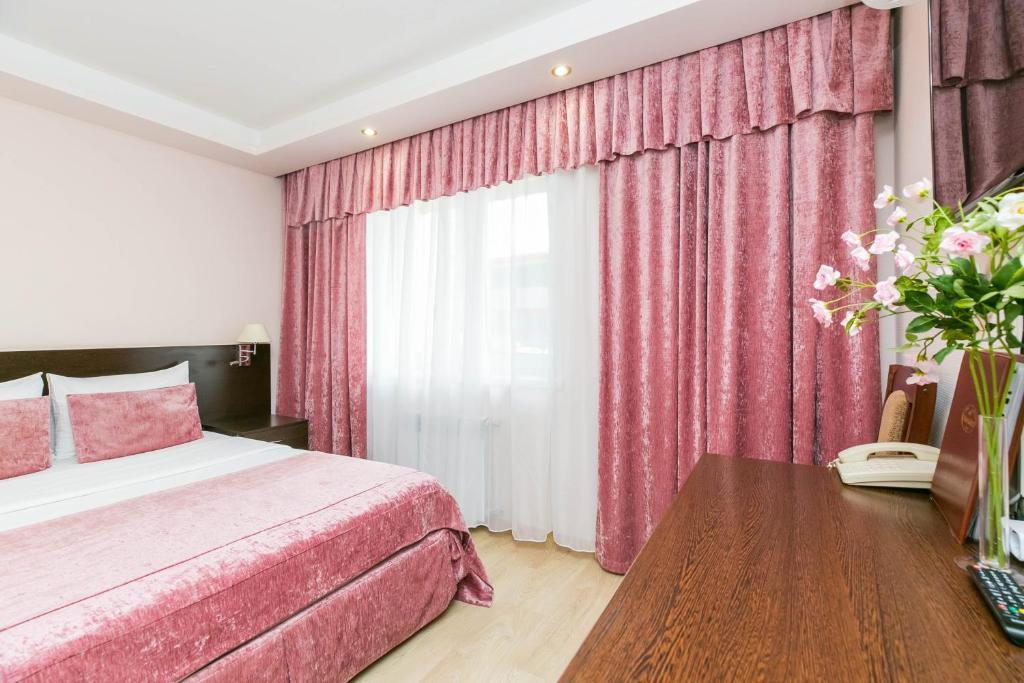 Кровать или кровати в номере Мини-отель Прогресс