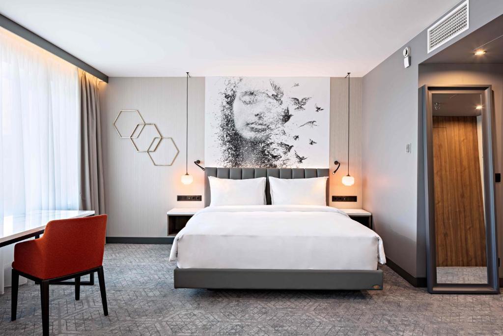 A bed or beds in a room at Radisson Blu Daugava Hotel, Riga