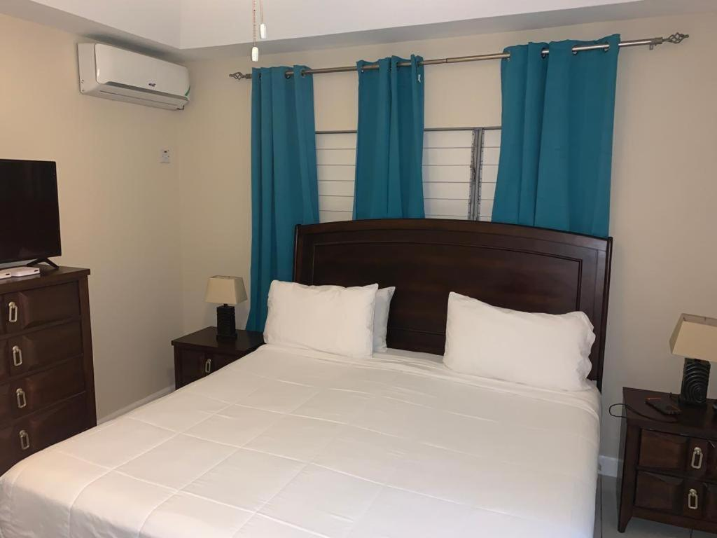 A bed or beds in a room at Tranquility at blissett