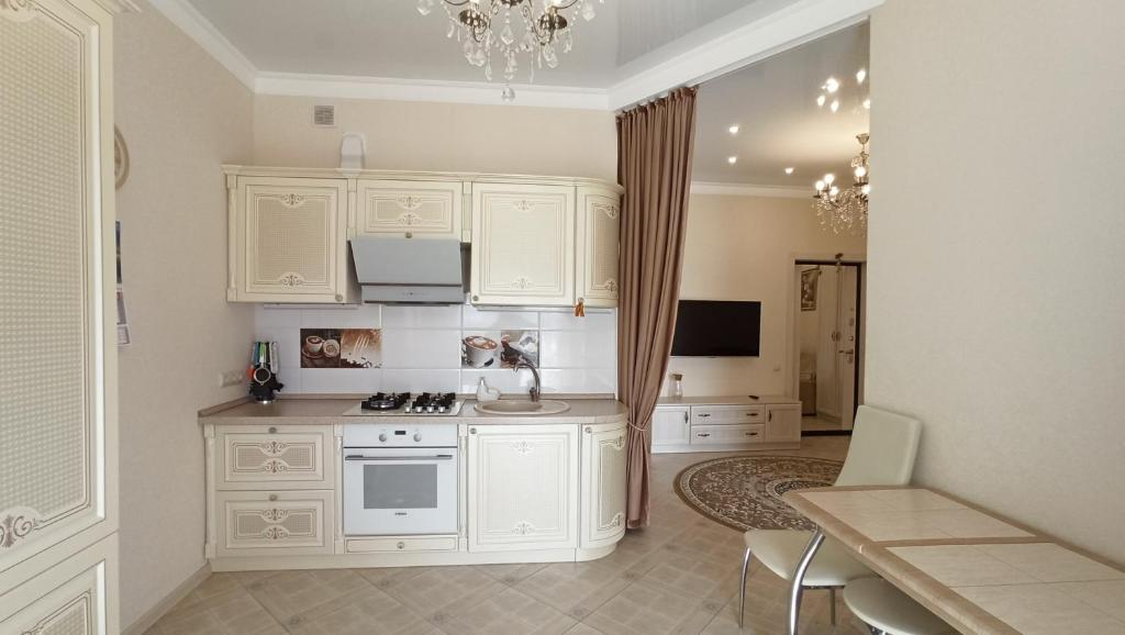 A kitchen or kitchenette at Апартаменты на Халтурина 30 КОМФОРТ