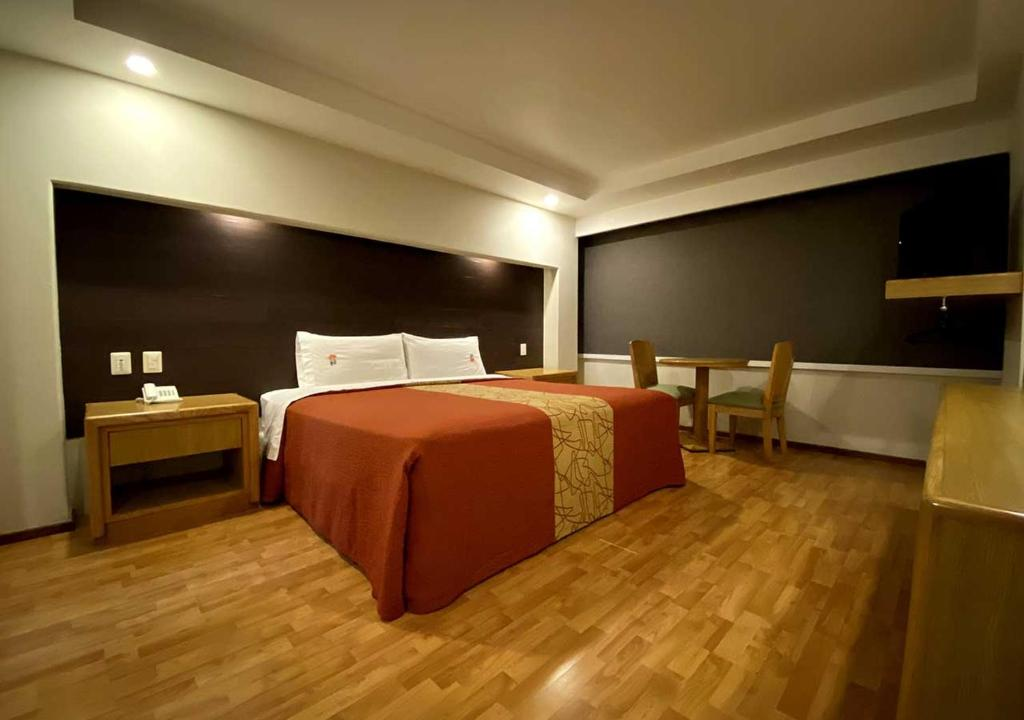 A bed or beds in a room at Hotel Lord