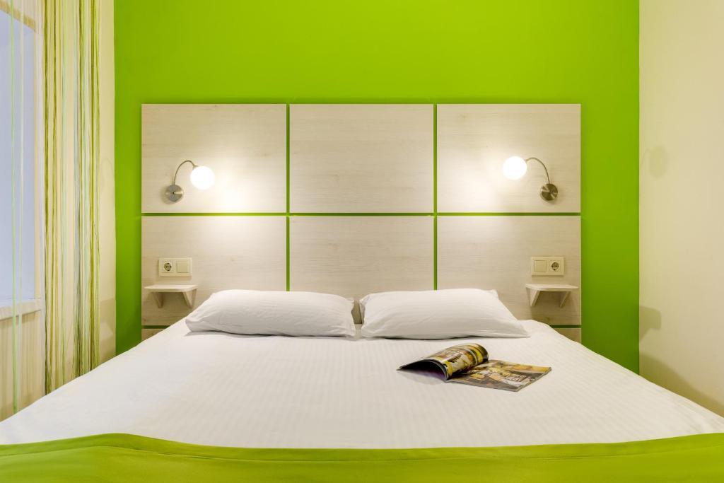 Кровать или кровати в номере Гостиница Ордынка