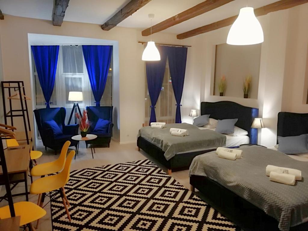 Łóżko lub łóżka w pokoju w obiekcie Great Polonia Wrocław City Center