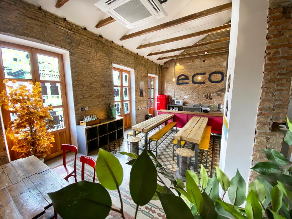 A restaurant or other place to eat at ECO Hostel