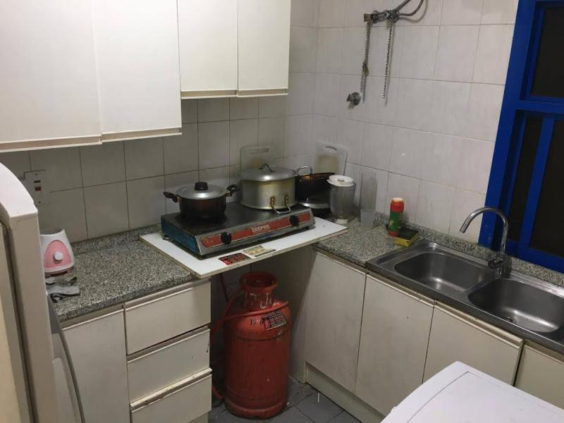 A kitchen or kitchenette at Ladies single bedspace in front of Karama Center!