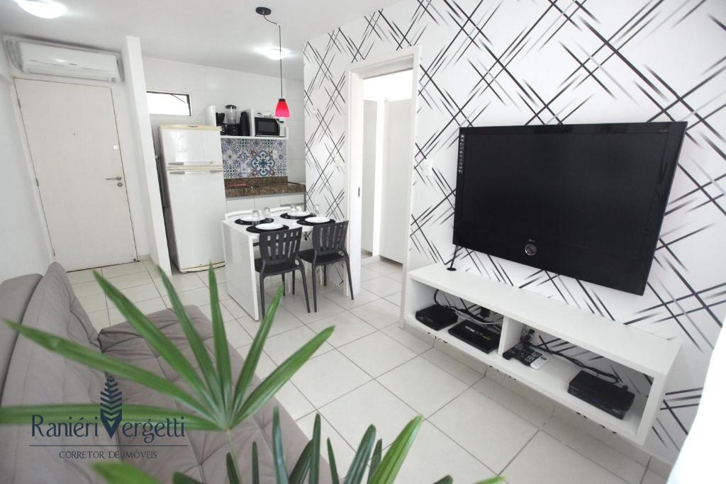 A television and/or entertainment centre at Paraiso, paz e conforto é aqui! Seja bem vindo(a).