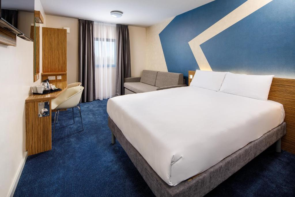 A bed or beds in a room at ibis budget London Heathrow T5