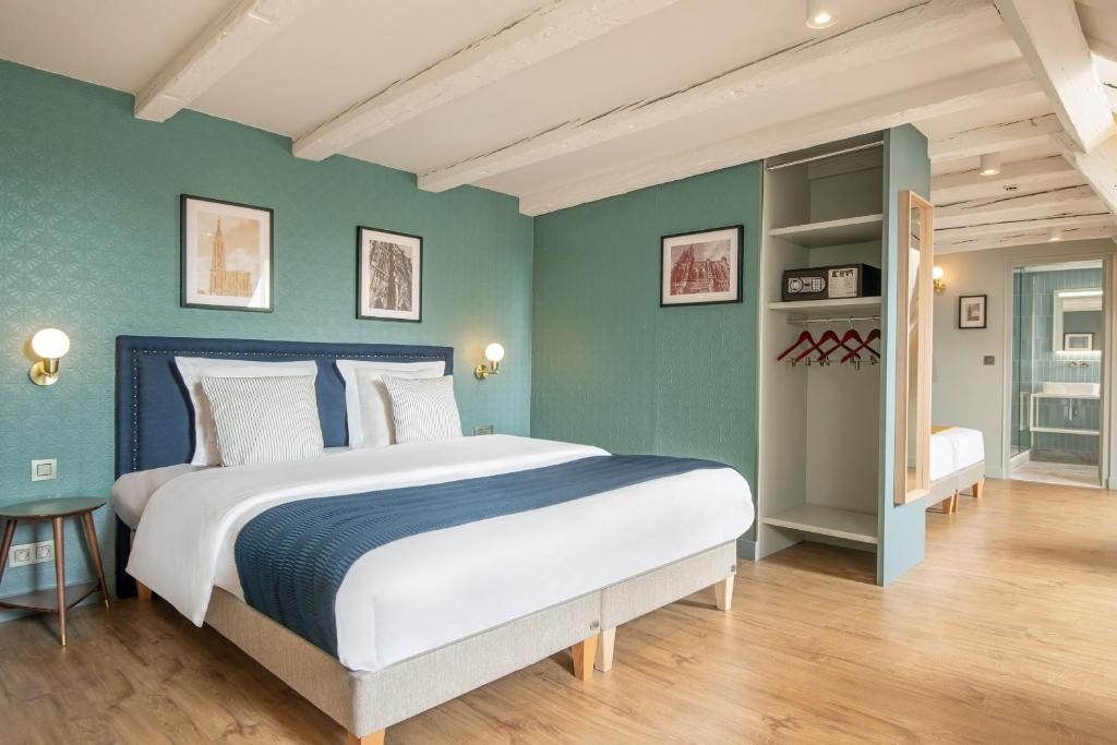 A bed or beds in a room at Hôtel de l'Europe by HappyCulture