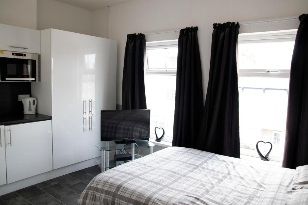 A bed or beds in a room at Bursar Street 19