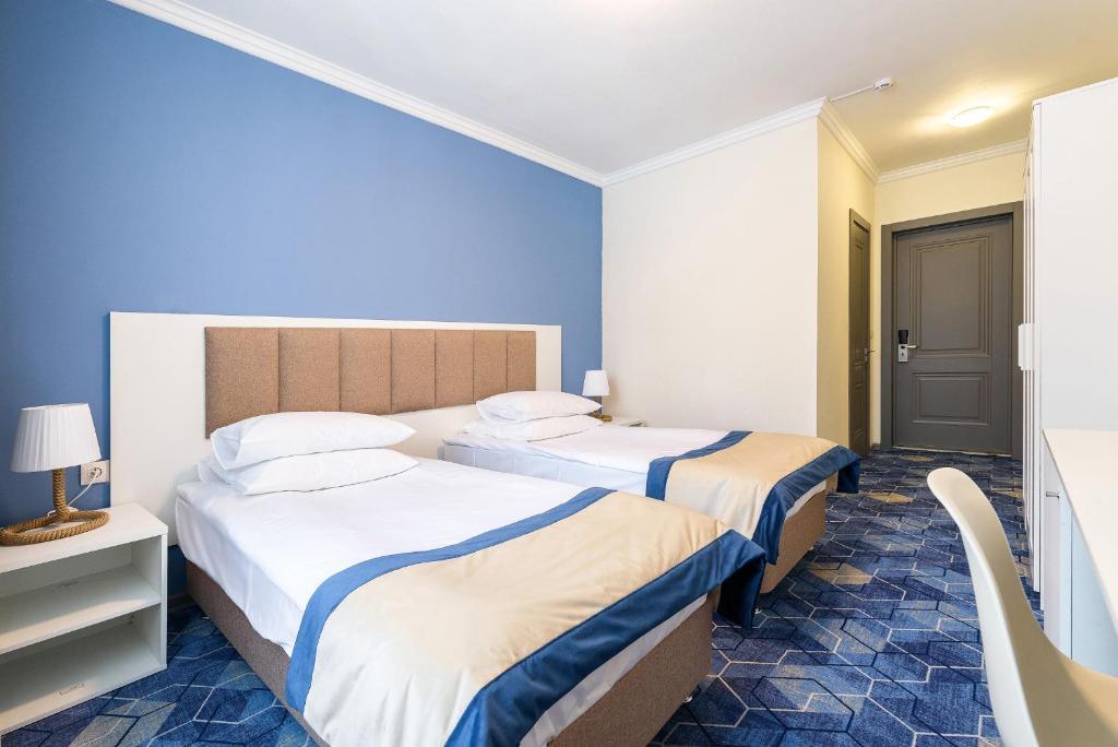 Кровать или кровати в номере Riverside by Welna