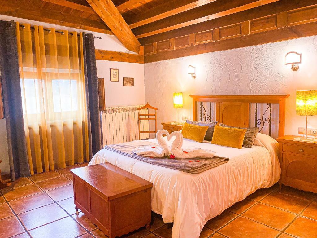 Cama o camas de una habitación en Posada Real de Carreteros