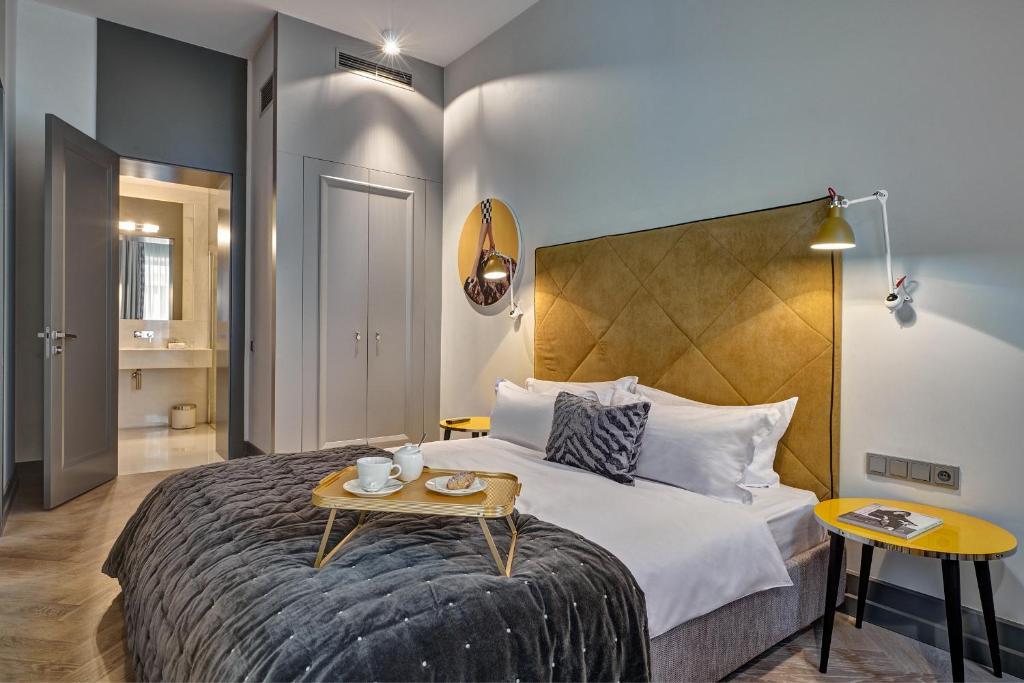 Łóżko lub łóżka w pokoju w obiekcie H15 Boutique Hotel