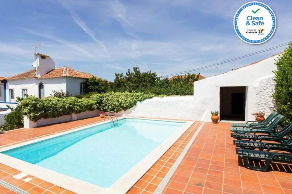 The swimming pool at or near Casa Do Sobral