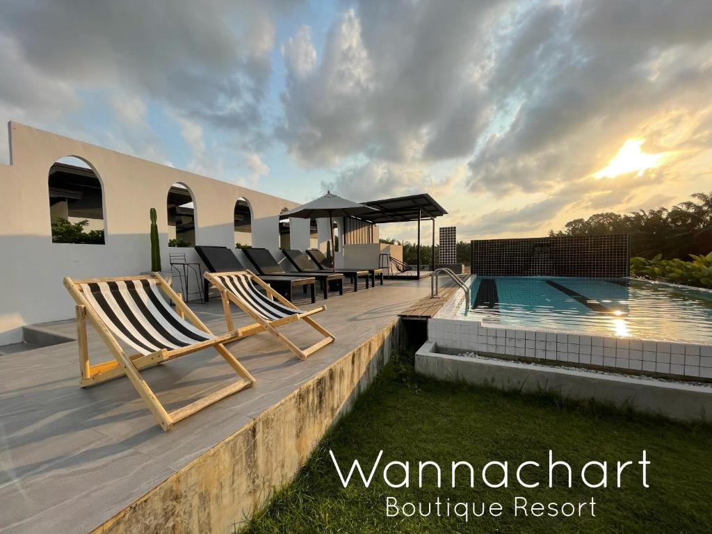 The swimming pool at or near Wannachart Boutique Resort