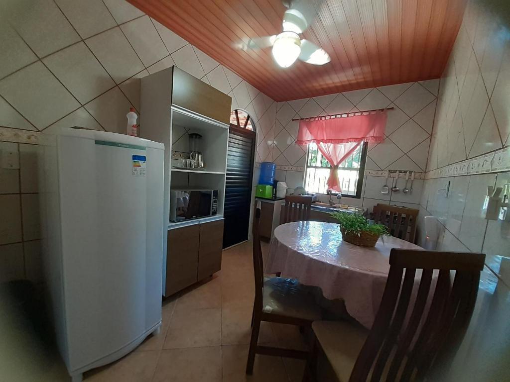 A cozinha ou cozinha compacta de Casinha do Trapiche