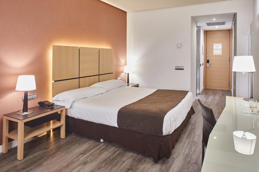 Cama o camas de una habitación en Silken Puerta Valencia
