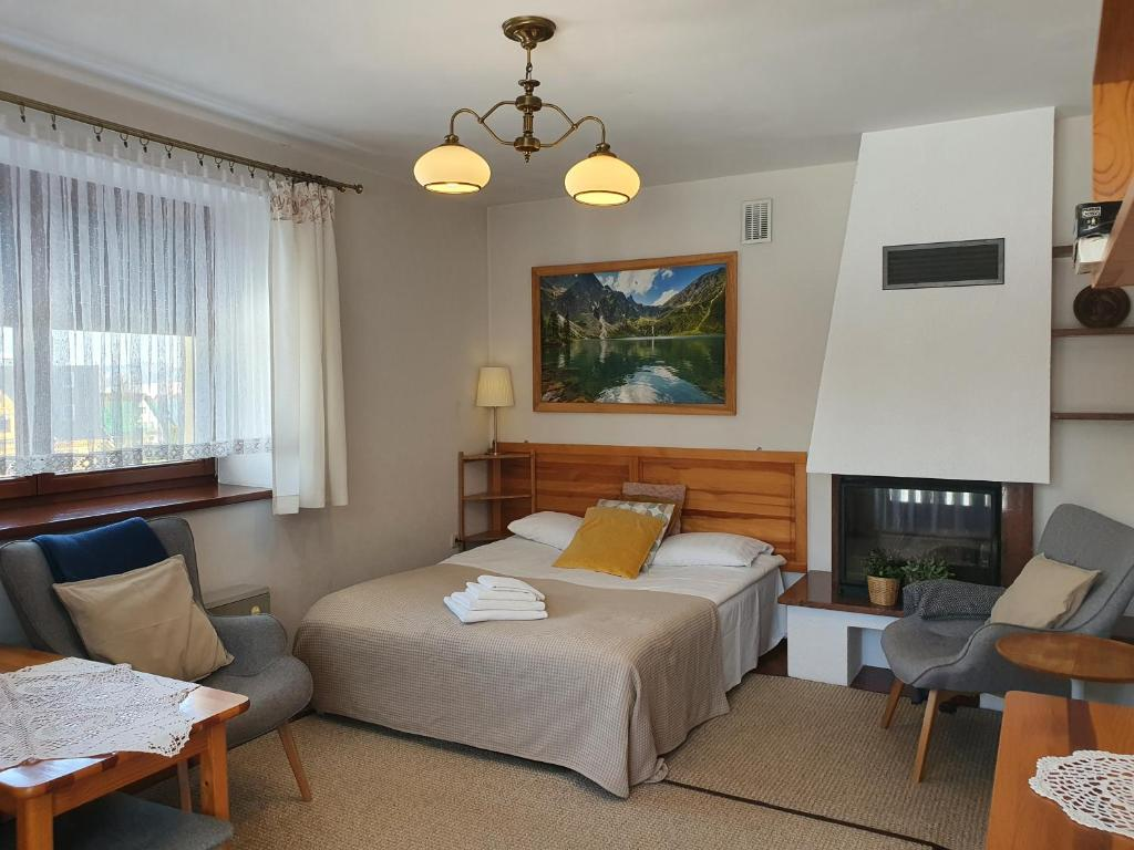 Łóżko lub łóżka w pokoju w obiekcie Apartament Iskra