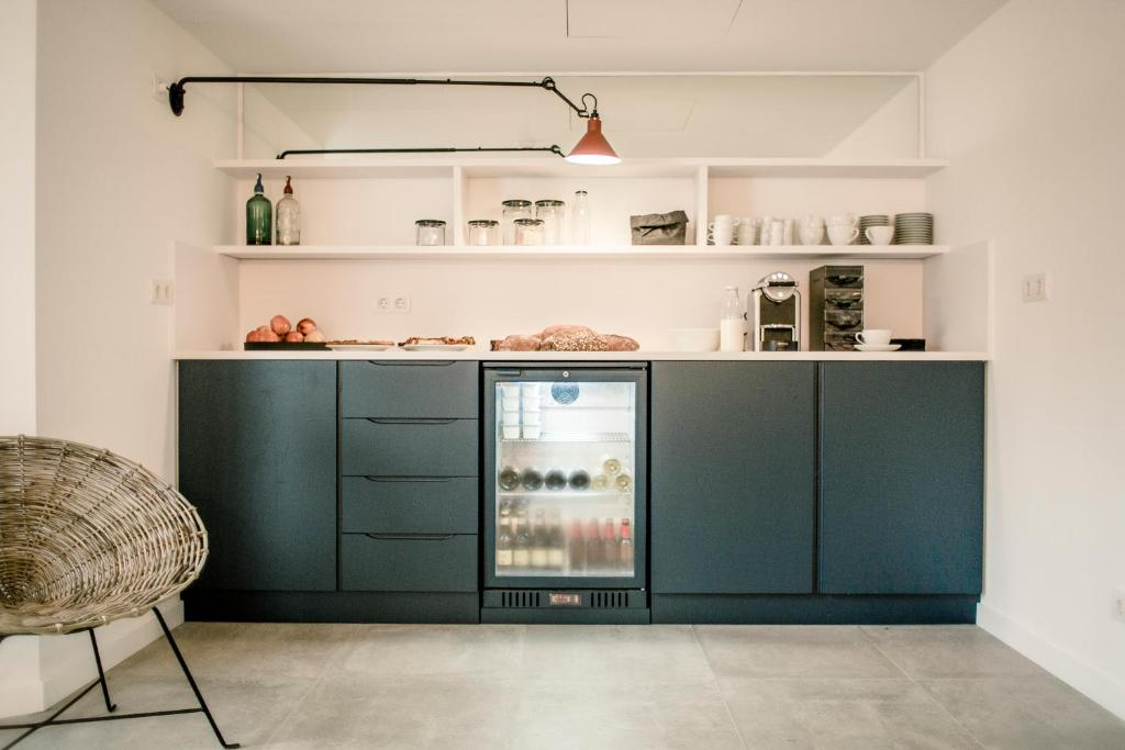 A kitchen or kitchenette at Tramuntana Hotel - Adults Only