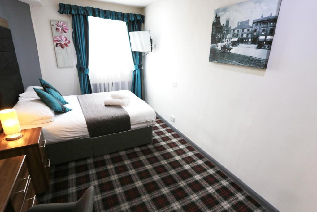 Huddersfield Central Lodge Hotel - Laterooms