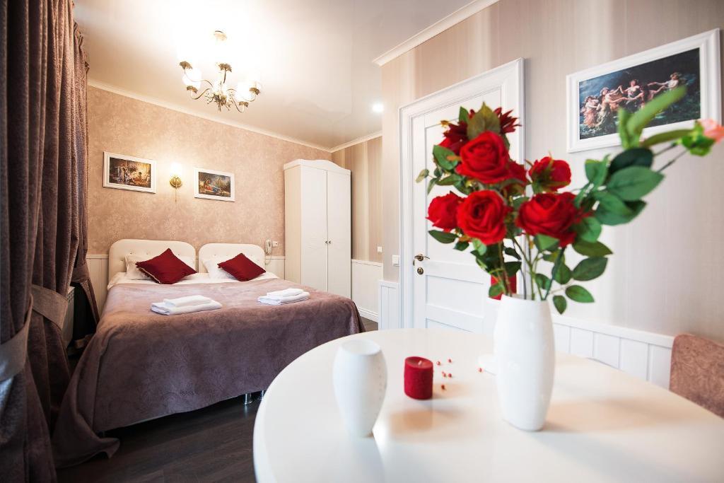 Кровать или кровати в номере Травелто Репина